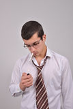 Young businessman using asthma inhaler to handle problems wit Stock Photography