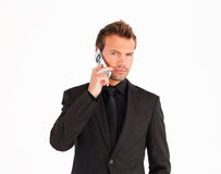 Young businessman using a cell phone Royalty Free Stock Images