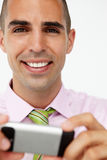 Young businessman using cellphone Stock Image