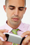 Young businessman using cellphone Royalty Free Stock Photography