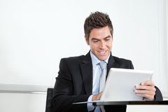 Young Businessman Using Digital Tablet In Office Royalty Free Stock Photo