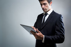 Young Businessman Using Digital Tablet Royalty Free Stock Photography