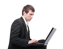 Young businessman using his laptop Royalty Free Stock Photography