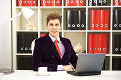 Young businessman using his laptop Stock Photo