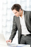 Young Businessman Using his Laptop While Standing Stock Photos