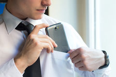 Young businessman using his mobile phone in office. Stock Image