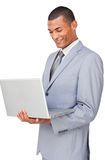 Young businessman using a laptop Stock Photography