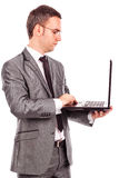 Young businessman using laptop Royalty Free Stock Photos