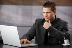 Young businessman using laptop in office Royalty Free Stock Images