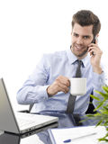 Young businessman using laptop. White background Royalty Free Stock Photo