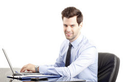 Young businessman using laptop. White background Stock Image