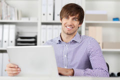 Young Businessman Using Laptop Stock Photography