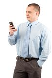 Young businessman using mobile phone Stock Photography