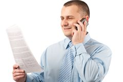 Young businessman using mobile phone Stock Photo