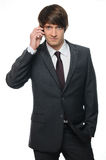 Young businessman using mobile phone Royalty Free Stock Photography