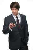 Young businessman using mobile phone Stock Images
