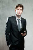 Young businessman using a mobile phone Royalty Free Stock Images