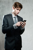 Young businessman using a mobile phone Stock Image