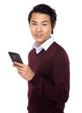 Young businessman using a mobile phone Stock Photos