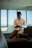 Young businessman using mobile phone at office Stock Photos