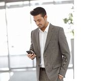 Young businessman using mobilephone Royalty Free Stock Photography