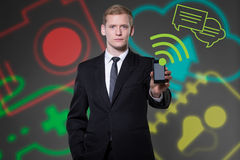 Young businessman using modern technologies Stock Image