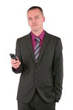 Young businessman using a smart phone Stock Image