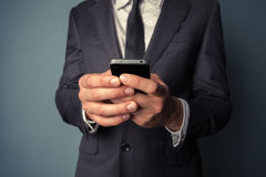 Young businessman using smart phone Royalty Free Stock Photography