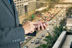 Young businessman using a smart phone. Stock Photo