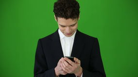 Young businessman using smartphone on chroma key background stock video footage