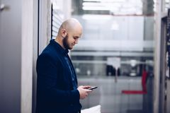 Young businessman using smartphone in the office stock photo