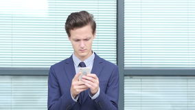 Young Businessman Using Smartphone, Outdoor stock footage