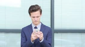 Young Businessman Using Smartphone, Outdoor. Creative designer , businessman stock footage
