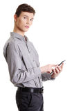 Young businessman using tablet computer. Isolated on white background Stock Photo
