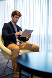 Young businessman using a tablet computer Royalty Free Stock Image