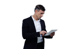 Young businessman using tablet computer Stock Photography