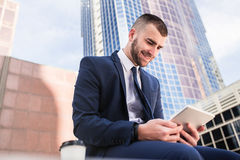 Young businessman using a tablet computer Stock Photos