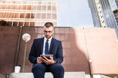 Young businessman using a tablet computer Stock Images