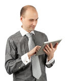 Young businessman using a tablet pc Stock Photography