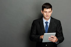 Young businessman using tablet pc Stock Images