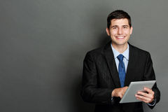 Young businessman using tablet pc Royalty Free Stock Images