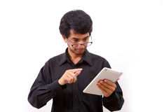 Young businessman using a tablet pc Stock Image