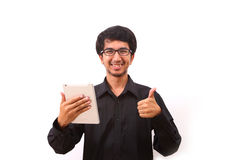 Young businessman using a tablet pc Stock Images