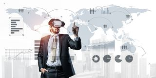 Experiencing virtual reality as new concept in technologies for business. Mixed media stock photos
