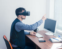 Young businessman in vr glasses drawing chart with gesture stock image