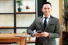 Young businessman waiting for meeting appointment at cafe Royalty Free Stock Images