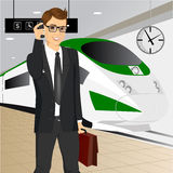 Young businessman waiting for the train Royalty Free Stock Image