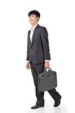 Young businessman walk Stock Images