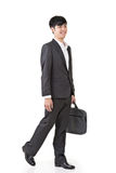 Young businessman walk Royalty Free Stock Photo