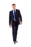 Young businessman is walking Royalty Free Stock Photos